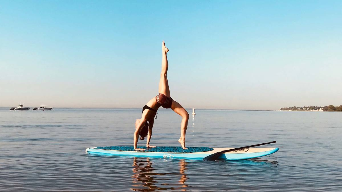 When surf meets yoga : SUP yoga - Aloha Surf Camp